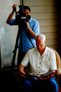Videographer, Brian, filming Tim