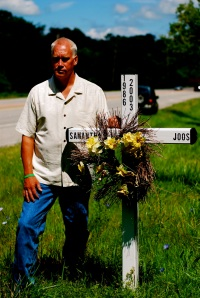 Tim at Sam's accident site memorial cross.