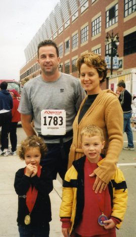 Colby with his wife and kids before a race.