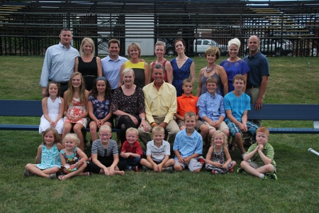 Mida and Tim surrounded by their family in the summer of 2012.