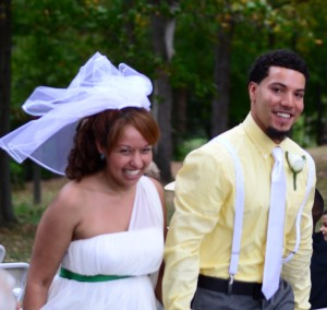 Yessina and Cory walking down the aisle