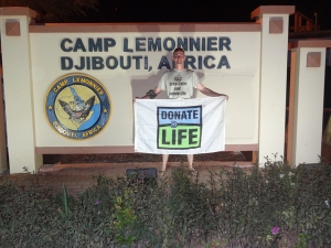 Erik with the Donate Life flag in Djibouti.